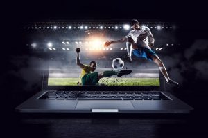 Football players on a monitor screen